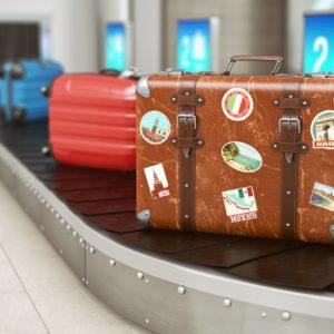 Old vintage suitcase on a airport luggage conveyor belt. Baggage