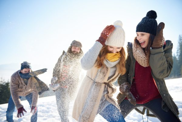 Boys against girls on the snowball fight