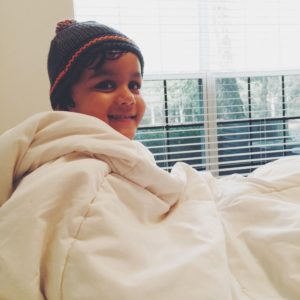 Comfy and Cozy #comforter #toddler #smiling #winters #indoor