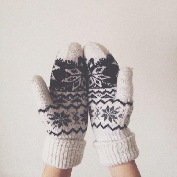 mittens on hands