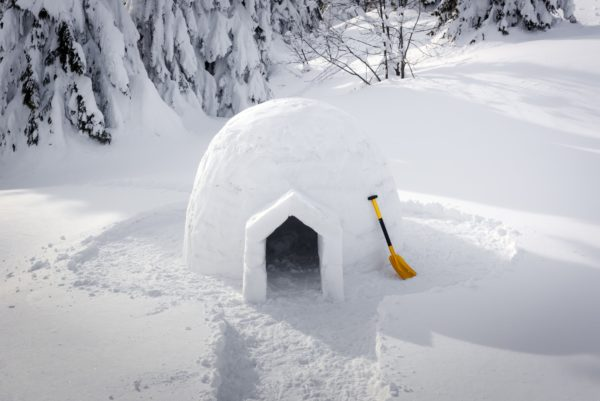 Real snow igloo house in the winter Carpathian mountains