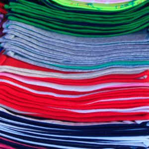 close up of a pile of tshirts